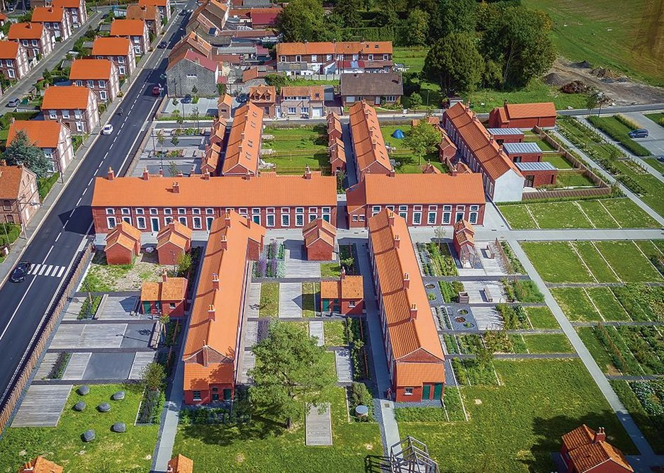 Aerial view showing the village restored. To the top are the rows of houses that remain for social tenants while the rest of the site is a museum, holiday lets and accommodation and studios for artists.