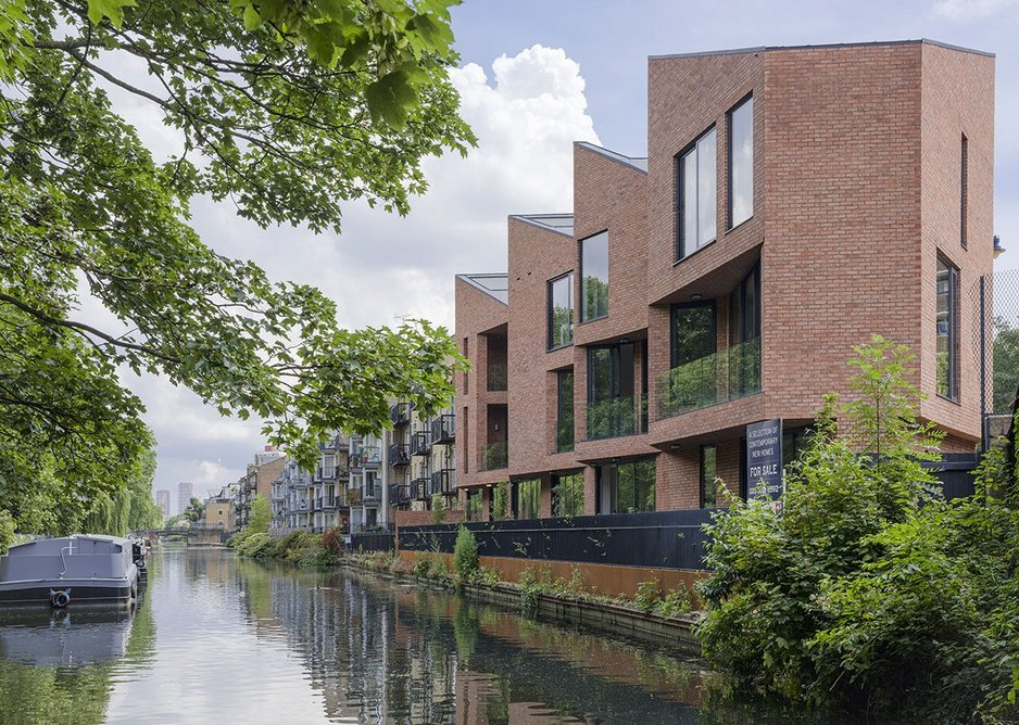 On the canalside the brick facade hovers over a glazed plinth giving onto a terrace.