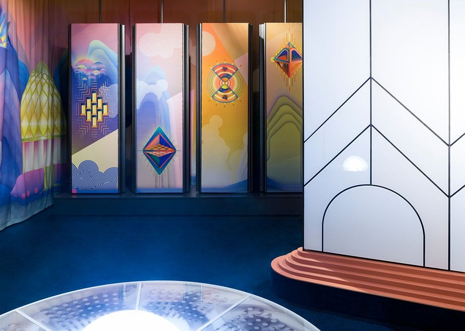The glass construction is surrounded by fabric panels with images inspired by Bruno Taut's utopian visions.