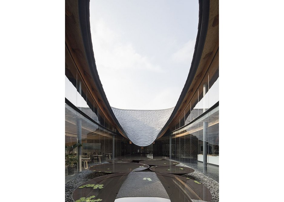 Inkstone House Cultural Centre, Sichuan Province, China (2018). A robotically controlled band-saw was again used to cut the beams, while sections of the brick wall were robotically prefabricated by Fab-Union.