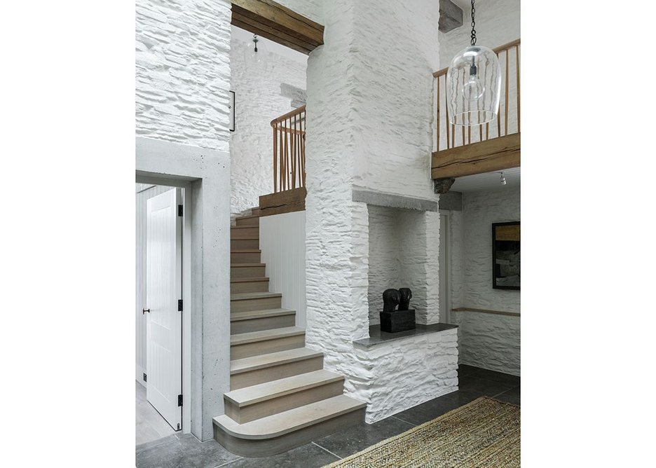 The texture of the rubble stone walls is brought together with a white slurry finish.