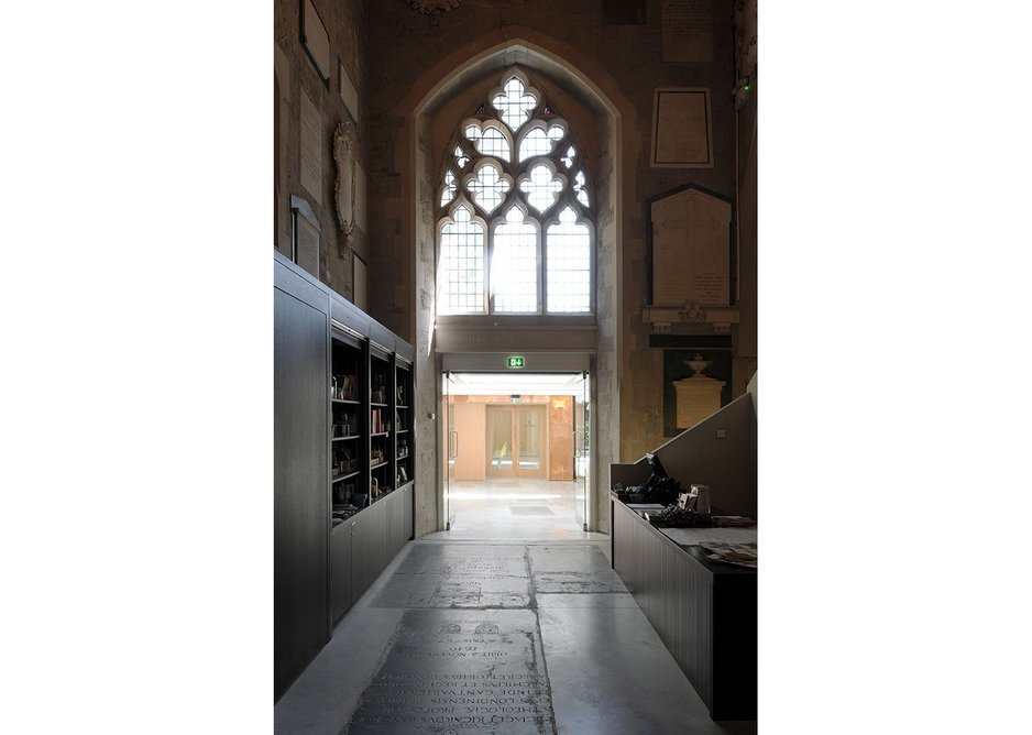 The entrance to the bright cloister as seen from inside the shop. A door to the museum offices is hidden in the shop's shelves to the left.