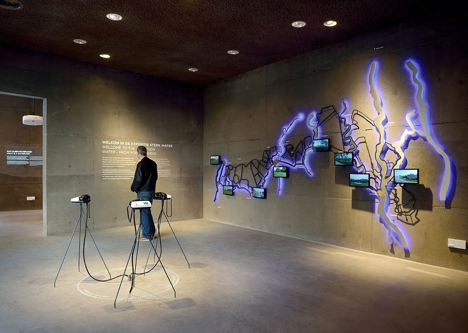 The exhibition, designed by Duinzand, barely touches the fabric of the new building with displays lightly mounted, freestanding exhibits and text carefully stuck onto the walls, which is sadly falling off in places already.