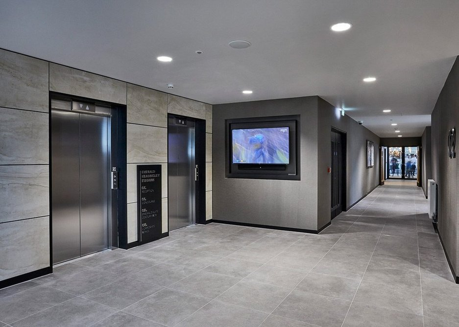Easy to maintain, anti-slip Eco Concrete tiles by Casalgrande Padana were chosen for the stadium's communal and entrance areas.