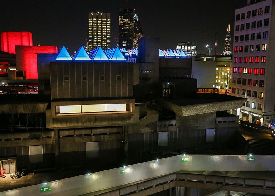 Artist David Batchelor's Sixty Minute Spectrum (2017) sequence of lighting allows the roof of the Hayward Gallery to function as a giant clock.
