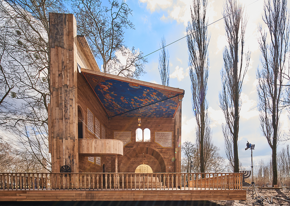 Inspired by pop-up books, Manuel Herz Architects' design unfolds manually to create a sheltered synagogue structure.