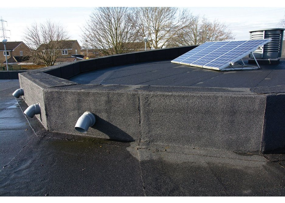 After remediation parapet detailing is well sealed and robust.