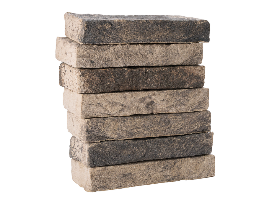 Lithium is a hand-formed facing brick made from a mix of different kinds of clay forms.