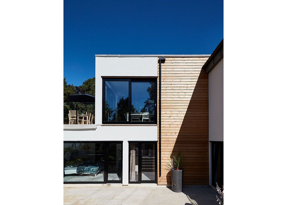 The Healthy House exterior is rendered with timber rainscreen cladding.