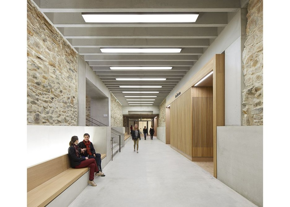 The basement has been excavated from between the foundations of the original building and made into a habitable space using concrete, oak and bronze.