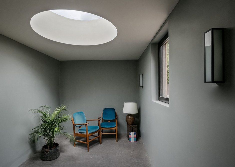 The second bedroom with its window over the walkway and circular skylight.