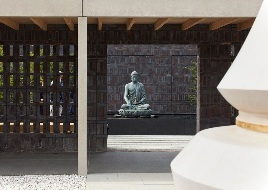 Buddha sits on a lotus flower in one of two Dharma jewel courtyards, the Akshobhya.