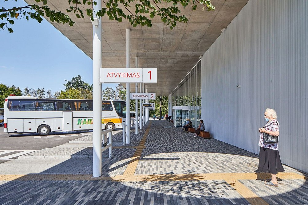 Full height glazing and robust zig zag section aluminium rainscreen cladding characterise more utilitarian facades on the bus station side.