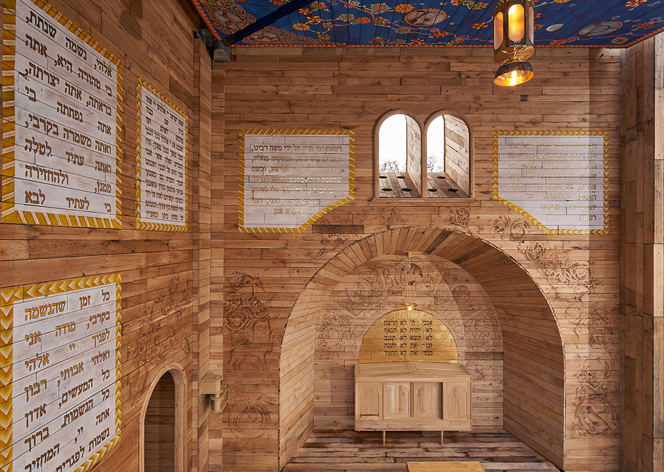The walls of the Babyn Yar synagogue are decorated with prayers, blessings and symbols referencing the interiors of historic wooden synagogues in Ukraine.