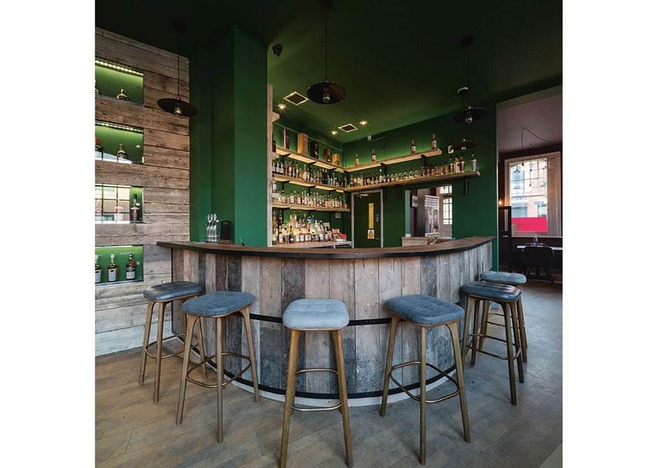 The project divided the space into three areas with the bar in the middle section.