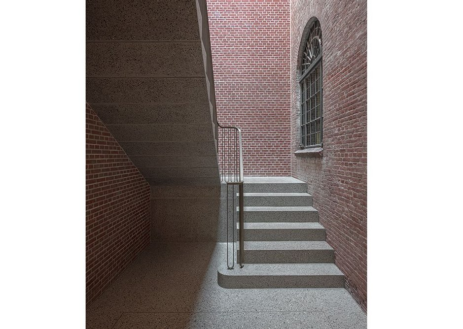 Access stair from vestibule to the first floor galleries.