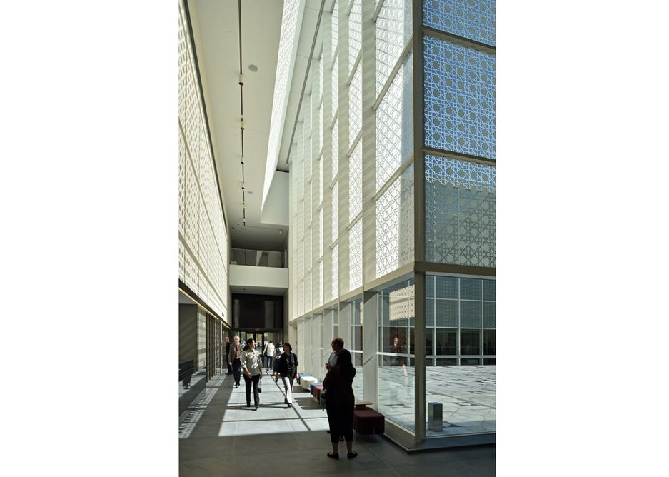 The central courtyard in Maki's museum employs Islamic geometric motifs as fritting in the glazing.