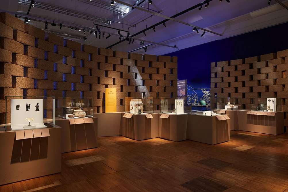 Blocks of Hempcrete form a permeable gallery wall in Epic Iran, an exhibition designed by Gort Scott at the V&A, London.
