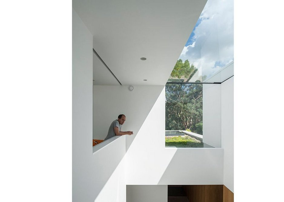 Horizontal and vertical glazing floods light into what could otherwise be a dark, enclosed space.