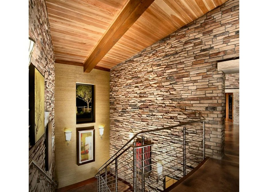 Stainless steel railings provide a clean modern fit with wood and stonework.