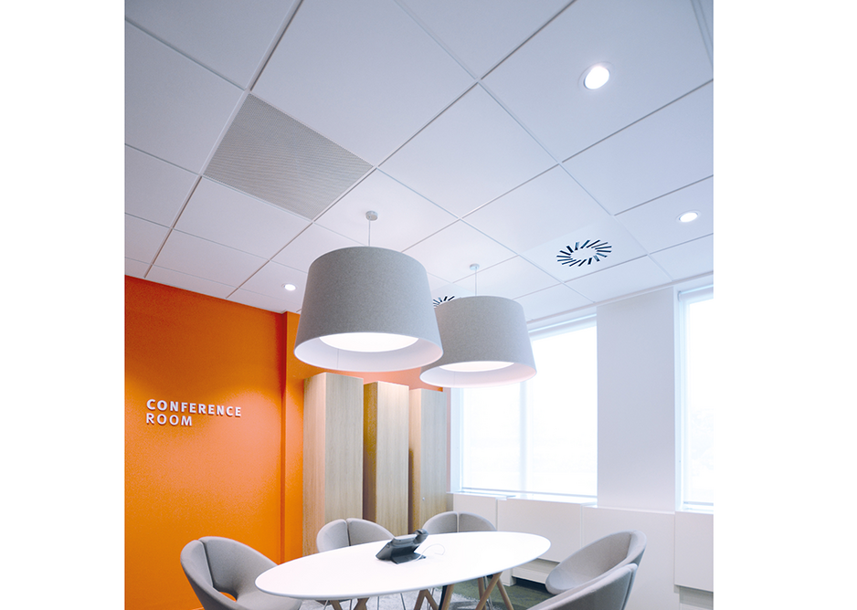Dune eVo dB ceiling tiles in a typical conference room setting.