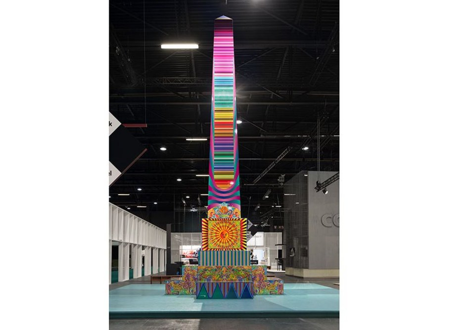 Adam Nathaniel Furman, Lumalisk, 2018 Biennale Interieur in Belgium. The hyper-coloured obelisk provided the exhibition hall with a conspicuous meeting point by drawing on a smorgasbord of influences, including the Flemish renaissance, Chinoiserie, Thai prints, Japanese sunrise symbolism and Italian radical design of the 1970s.