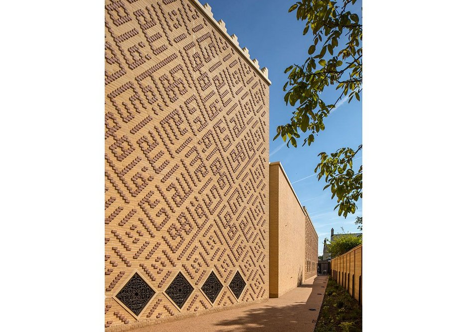 The exterior walls are faced in brick cladding hung from CLT timber panels. The brick has been chosen to reflect the light buff of Cambridgeshire gault brick, while being decorated with Arabic inscriptions in the Kufic style.