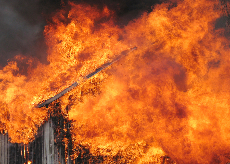 The intense heat of a blaze in a historic building.