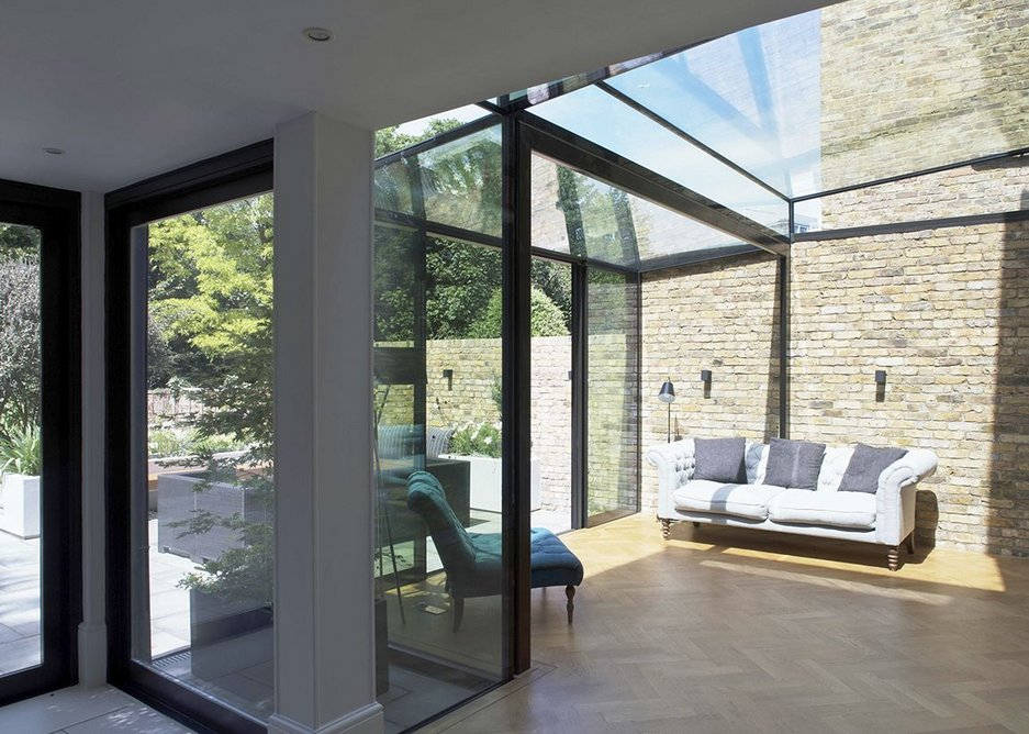 Glazing options for doors, windows and ceilings create bright, open and versatile spaces in this extended home.