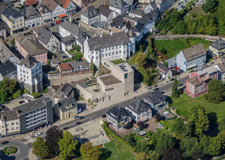 The museum mediates between the historic hilltop centre and newer parts of the town below and around it.
