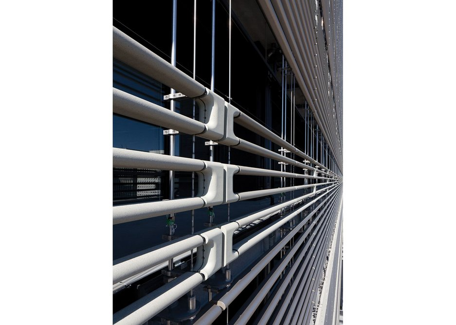 The east facade is effectively a mesh  of pipework keeping local temperatures at its surface lower