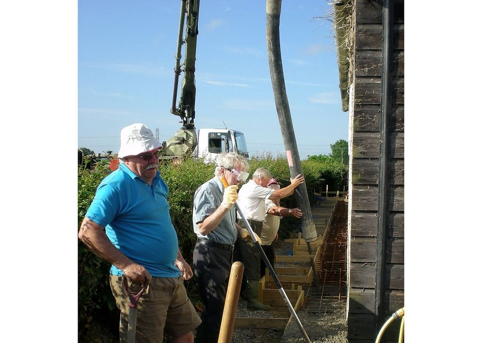 Villagers doing it together to build Burtle's community hall in Somerset.
