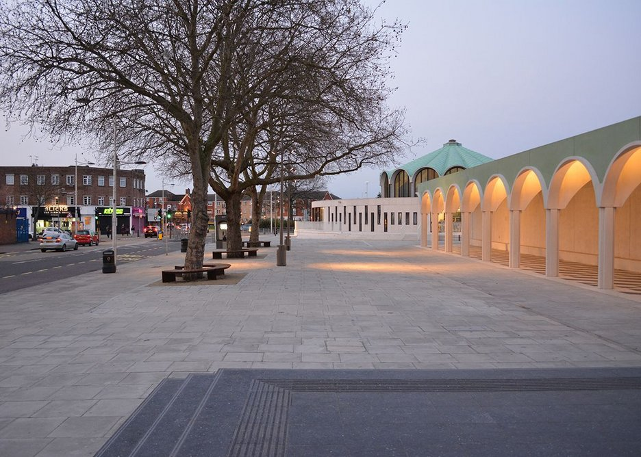 New town square, primed for events, includes existing trees.