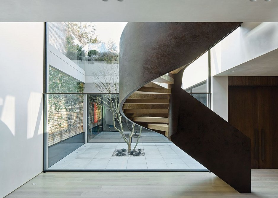 Stair into basement with view through to courtyard.
