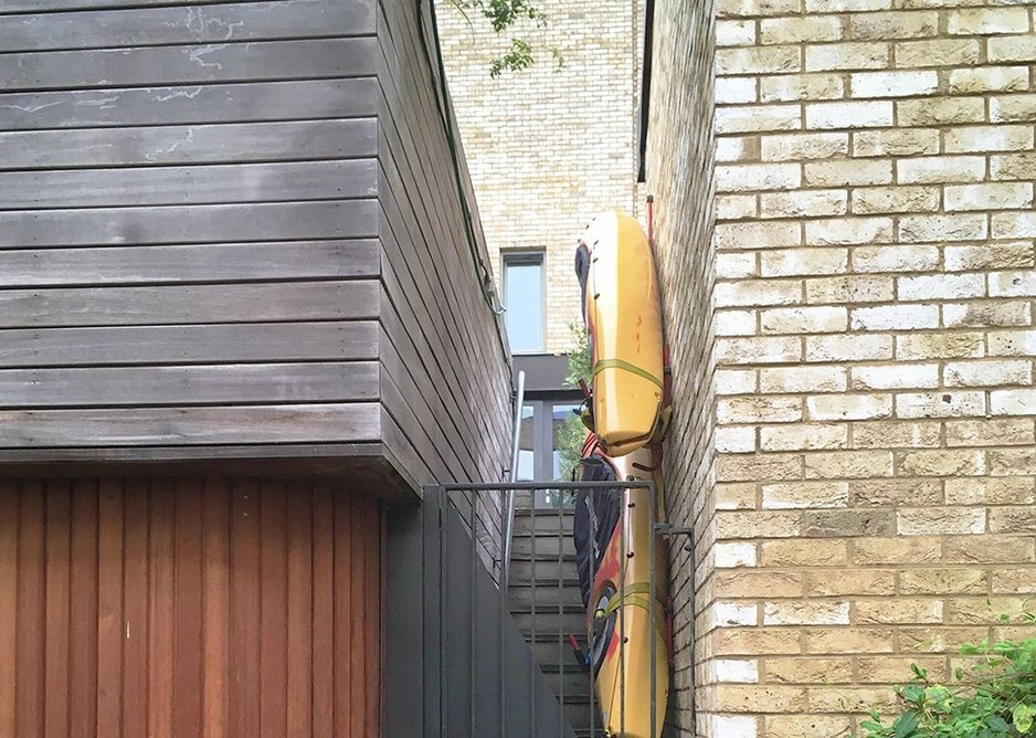 Signs of life: a rear staircase repurposed as boat storage