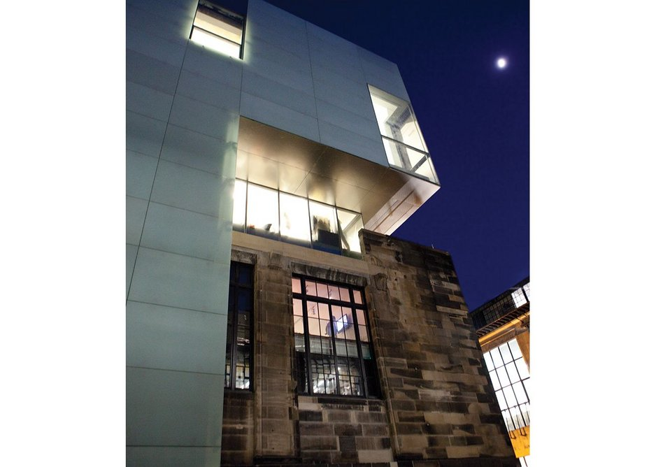 The crisp glazing of the new contrasts with the retained Assembly building.