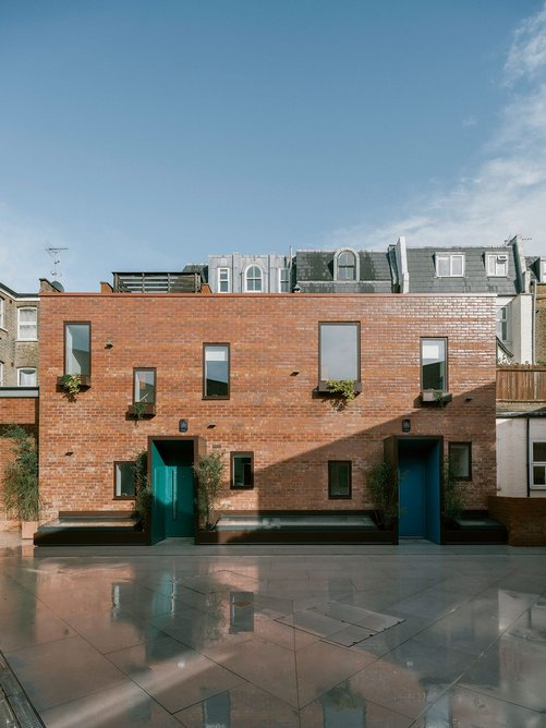 The rear of Lillie Road's Victorian parade pokes up beyond the top of two of the new houses.