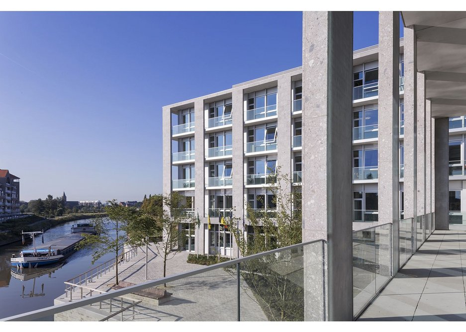 View towards administration wing from the terrace adjoining the council chamber. Marie-Josee Van Hee Architecten's new jagged bank borders the river Leie.