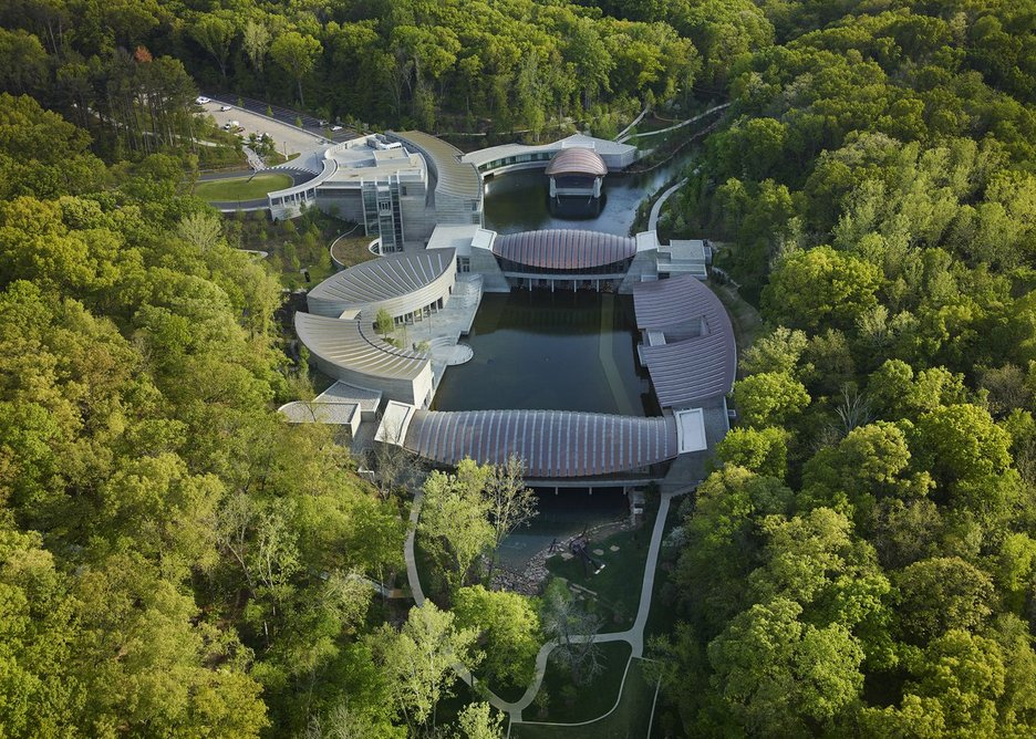 Crystal Bridges Museum of American Art seen nestled into the landscape.