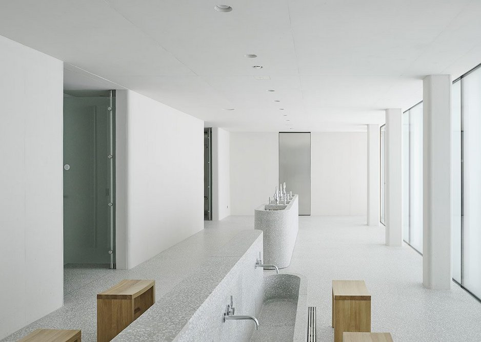 The washing room with terrazzo sanitaryware is located beside the main mosque hall as part of the ritual of cleaning before entering.