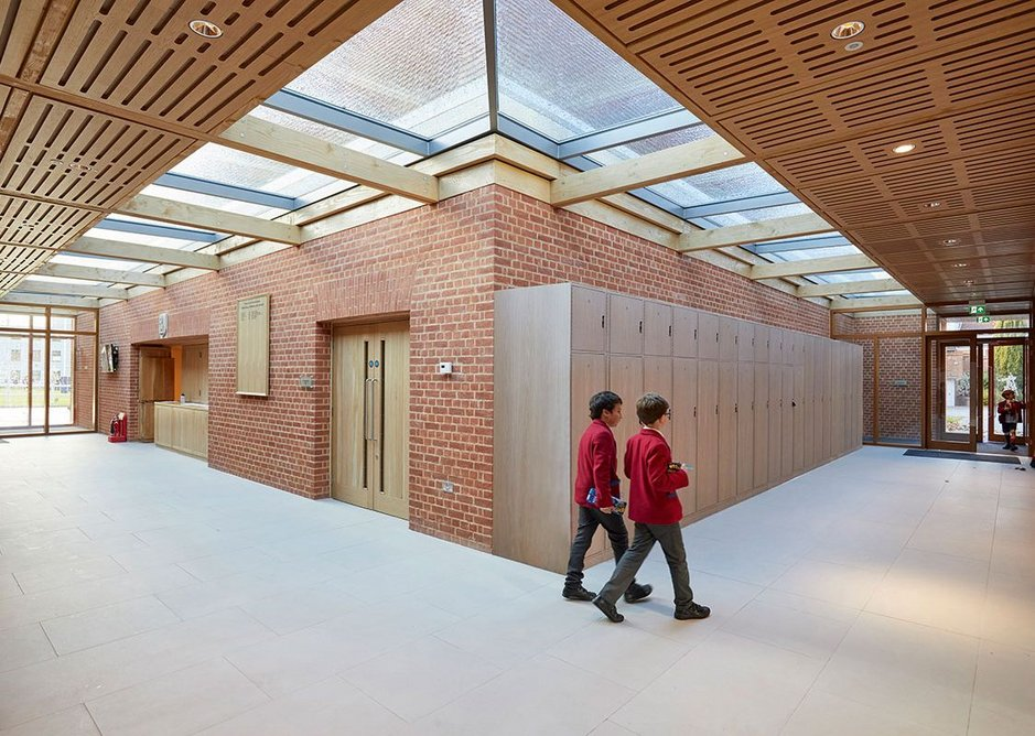 Well daylit foyer space with instrument lockers.