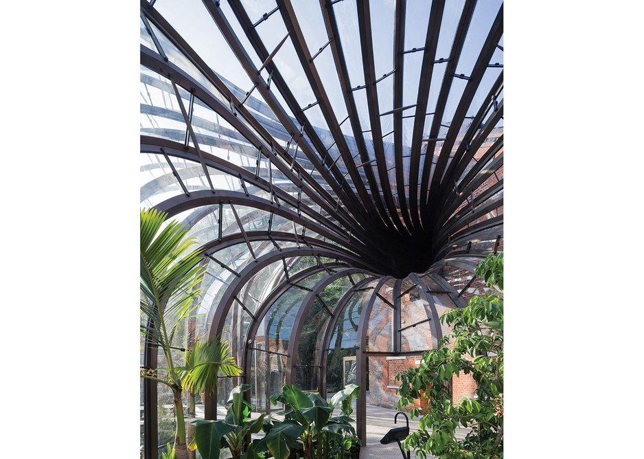 The geometry emphasises the flow of air through, up and away from the glass houses