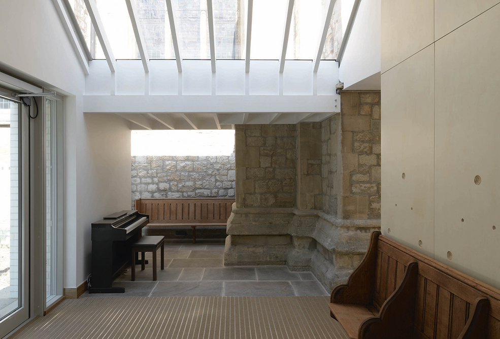 The entrance hall where niches fit around the original church walls..