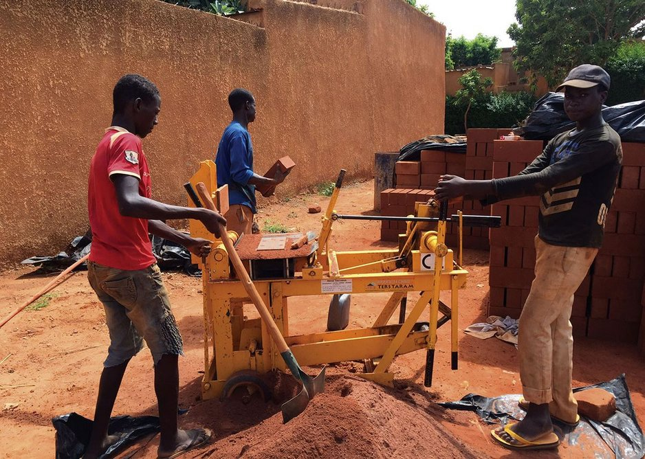 Compressed earth block production at Niamey 2000 designed by united4design