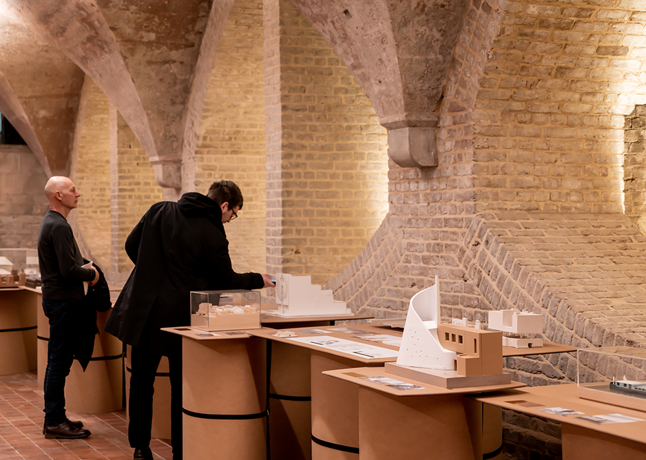 Installation view of Congregation. In the foreground is the proposed Scroll Church URC in Watford. Designed by Theis + Khan, the form is a celebration of Watford's paper making industry in the form of a religious scroll.