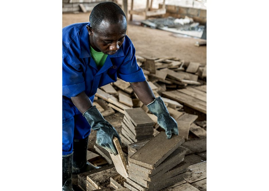 Workers on the project were trained in making earth-pressed tiles with hydraulic machines on site.
