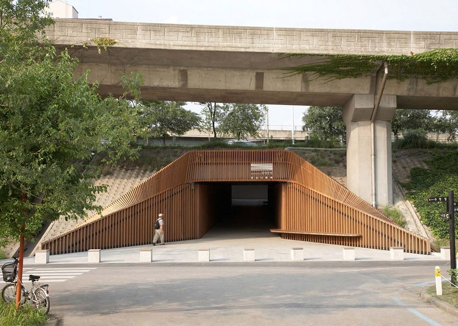 Seongsan Underpass with a reworked entrance in slatted wood hinting at the landscape beyond rather than acting as a reminder of the civil engineering above and below.