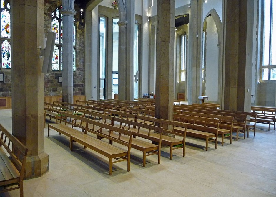 Light oak benches are stackable, underfloor heating keeps the cathedral warm.