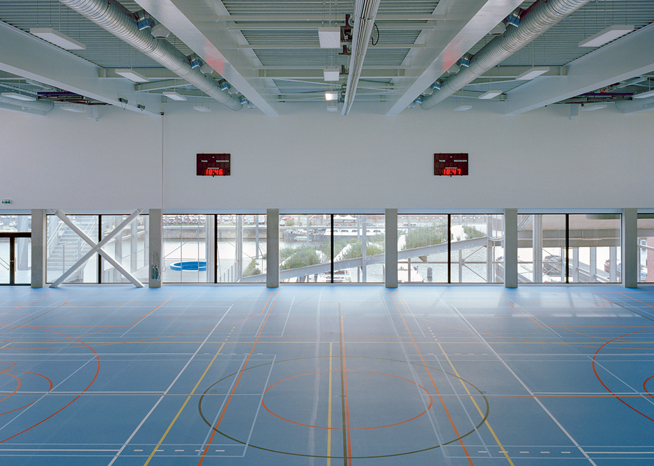 Views out from the sports hall show the inter-relationships of internal with external spaces in the building.