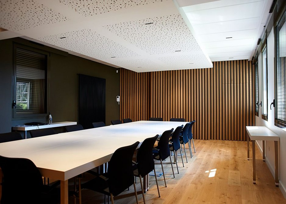 CMMA board room with conference tables and consoles in HI-MACS Alpine White.
